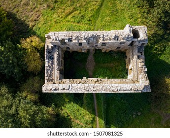 Top down, aerial view of Whorlton Castle Gatehouse ruin in North Yorkshire England.