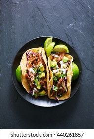 top down photo of two Mexican carnitas tacos on place in flat lay composition