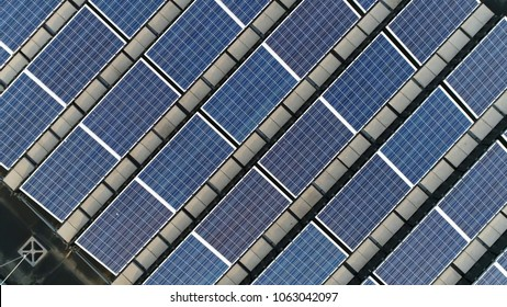 Top down picture of solar panels PV modules mounted on flat roof photovoltaic solar panels absorb sunlight as a source of energy to generate electricity creating sustainable energy