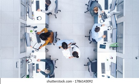 Top Down Shot of Big Busy Corporate Office with Tow Rows off Businessmen and Businesswomen Working on Desktop Computers. Bright Open Space Office with Businesspeople and Salespeople