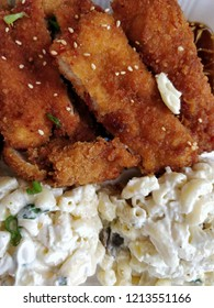 Top down shot of some spicy chicken katsu and Hawaiian style macaroni salad.