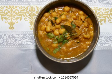 Top down view of a bowl of Chickpeas curry or Chola masala