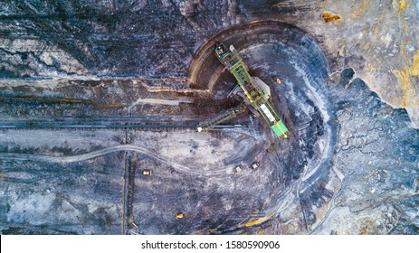 Top down view of bucket wheel excavator, heavy equipment for surface mining. Turow coal mine, Poland, European union. Mining from drone view. Background concept.