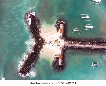 Top down view of the Candidasa jetty with traditional fisherman boats in Bali, Indonesia