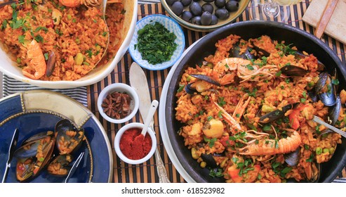 Top down view of delicious Spanish seafood paella: mussels, king prawns, langoustine, haddock