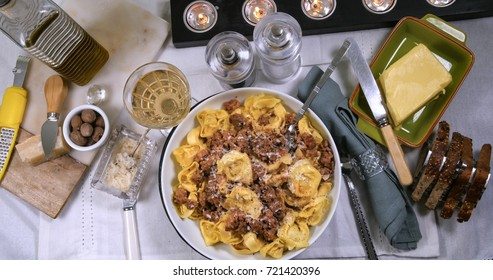 Top down view of delicious steamy tortellini in bolognese sauce (pasta)