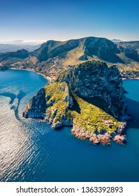 Top down view from flying drone. Amazing morning scene of Zafferano cape with old lighthouse. Incredible  spring seascape of Mediterranean sea, Sicily, Italy, Europe. Traveling concept background.
