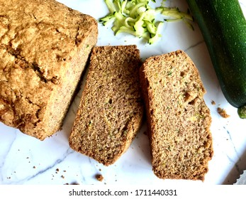 Top down view of freshly baked and sliced zucchini bread