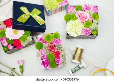 Top down view of modern, colorful flower boxes - unusual alternative to chocolates for Mother's or Valentine's day.
