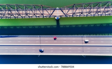 TOp down view on the bridges of M1 motorway Sydney to Newcastle over Hawkesbury river on a sunny summer day. Mighty australian river flows into pacific ocean on NSW central coast.