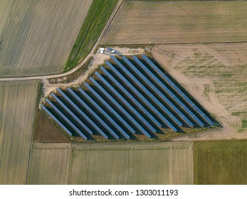 Top down view on solar panels farm on fields. Top down aerial landscape.