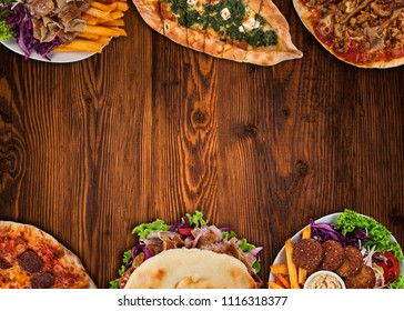 Top down view on traditional turkish meals on vintage wooden table. Close-up.
