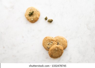Top Down View on White Marble of Edible Marijuana Chocolate Chip Cookies and Buds