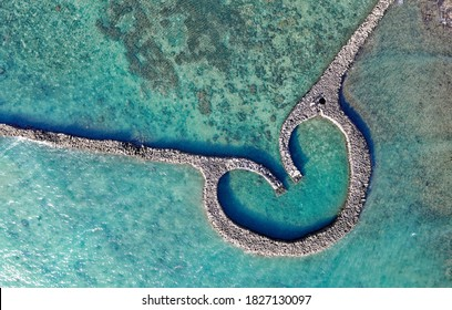 Top down view of the One-Heart Stacked Stones (Eye of Tiger Fish Trap) bathed in the turquoise sea water, which is a traditional fishing weir and a popular tourist attraction, in Xiyu, Penghu, Taiwan - Shutterstock ID 1827130097