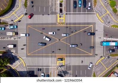 Top down view of road intersection with crowded vehicles in Jakarta city