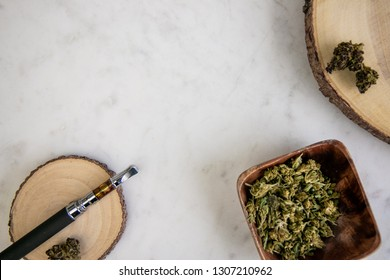 Top Down View of Vape Pen, Shake, Marijuana Buds on Wood - Cannabis Dispensary Products