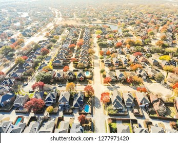 Top drone view lakeside residential neighborhood with cul-de-sac (dead-end) in North of Dallas, Texas, USA during fall season. Row of single-family houses subdivision with colorful autumn leaves