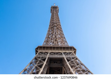 Top of Eiffel Tower in the morning. Blue sky with no clouds. No tourists. Close up shot. Paris, France