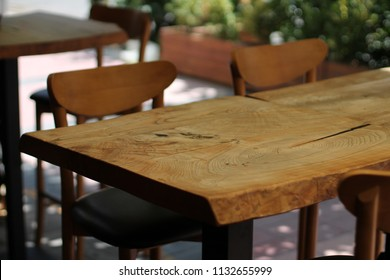 Top of the empty tree table and chairs restaurant atmosphere. Design wood table.