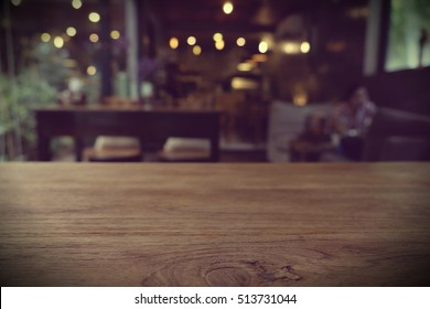 Top of empty wood table with Bar Cafe Restaurant blurred background, product display template, Business presentation