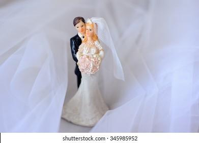 Top figurines of bride and groom