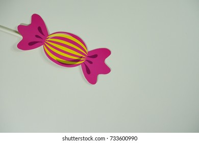 Top or flat lay view of birthday props, colorful candy on isolated white background. Birthday parties text and props.
