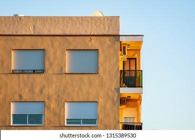 Top floor apartament building in warm sunset light