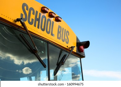 A top  front of a schoolbus over a blue sky