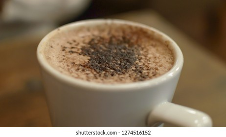 Top of a Frothy Hot Chocolate Mug with Cocoa Sprinkles, shallow depth of field