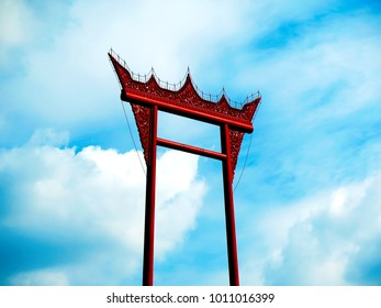 Top of Giant Swing in Bangkok Thailand on cloudy deep blue sky, important historical