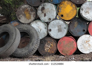 top of grunge barrels stacked in row