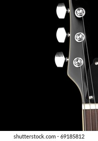 top of the guitar neck over black background, for entertainment or concert themes