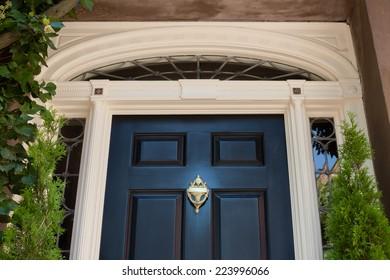 Top Half of Black Front Door with White Door Frame