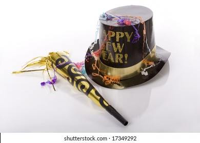 Top hat that says happy new year and other party favors isolated against white background
