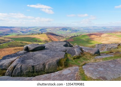 From the top of Higger Tor, across the Derbyshire Peak District on a hazy spring day.