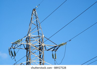 Top of high-voltage power line grey metal tower