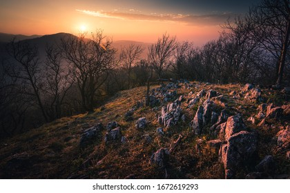 Top of hill Vapenna in Carpathians during sunset with rocks