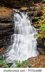 The top of Huron Falls, a beautiful waterfall in Pennsylvania's Ricketts Glen State Park, twists as it cascades down the rocky landscape of the park's Glen Leigh.