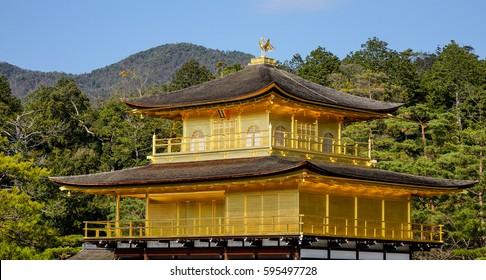 Top of the Kinkaku-ji Temple in Kyoto, Japan. The Golden Pavilion (Kinkaku) is a three-story building on the grounds of the Rokuon-ji temple complex.