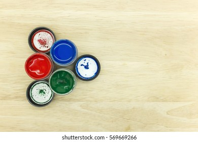 top left view of three basic color red, green and blue on the wooden background