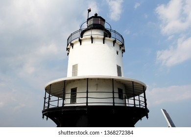 Top of a Lighthouse Becon against a blue summer sky