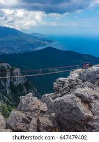 Top of the mountain Ay-Petri, the highest mountain of the Crimea, Gaspra, near Yalta. The suspension extreme bridge between teeth Ay-Petri. Beautiful mountain landscape