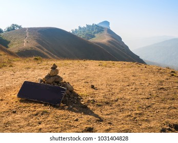 top mountain with empty signpost