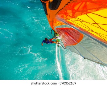 Top mounted camera photo of windsurfing riding on the on turquoise water