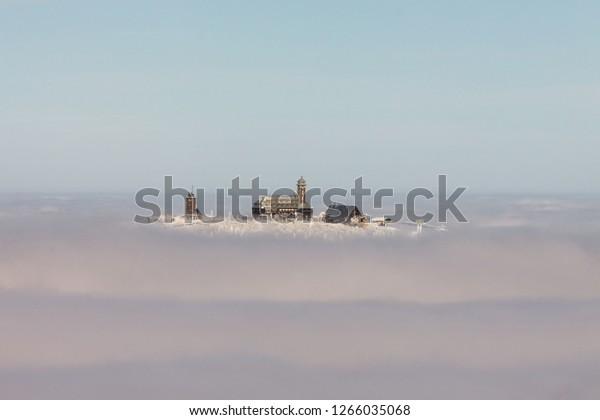 Top of Mt. Fichtelberg protrudes out of the cloud ocean