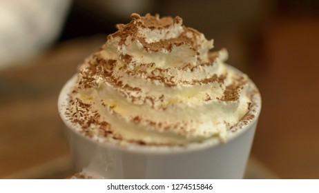 Top of a mug with Whipped Cream and Chocolate Sprinkles, shallow depth of field