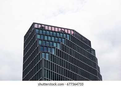 Top of a new modern office building made of glass on the Roosevelta street on a cloudy day in Poznan, Poland on July 2017