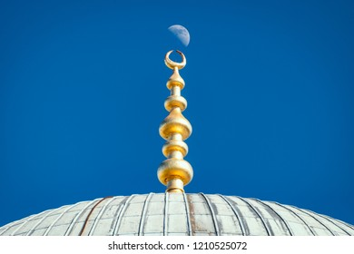 Top of old and beautiful Sultan Ahmed Mosque (Blue Mosque) Ottoman imperial mosque located in Istanbul, Turkey. Moon and sky in background.