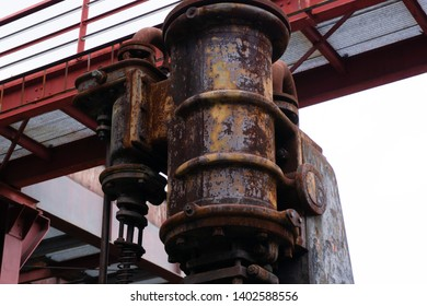 Top of an old, rusty and dezerted squeezer - Shutterstock ID 1402588556