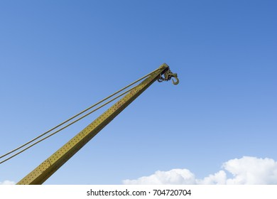 Top of an old, small, decommissioned crane on the Murray River wharf at Murray Bridge, South Australia. Reaching for the sky with the ropes and hook are in view.